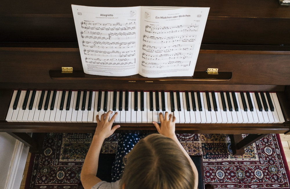 Above view of a child playing piano